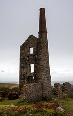 Engine House - Carn Galver Tin Mine, Cornwall (splib1) Tags: ocean uk sea chimney green weather rock stone century canon dark landscape dead tin grey coast ruins mine cornwall stones foreboding 19thcentury ruin engine eerie calm stack atlantic mining erosion restored bleak jagged weathered restoration serene algae wilderness shaft tinmine carngalver lifeless chimneystack enginehouse carn galver splib1