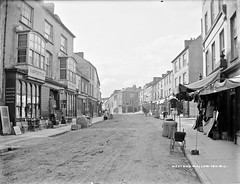 The West End is definitely the place to go ... in Mallow! (National Library of Ireland on The Commons) Tags: poster mallow cart westend countycork glassnegative raffertys robertfrench williamlawrence nationallibraryofireland corkexaminer lawrencecollection leaningonalamppost lawrencephotographicstudio thelawrencephotographcollection chattelsandwares raffertysdrapery