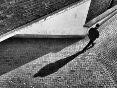 Mid-stride (dave777_uk) Tags: nottingham blackandwhite monochrome contrast walking olympus stride broadmarsh epl7