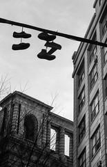 This Weather (adrianmojica) Tags: city newyorkcity blackandwhite bw film monochrome silhouette skyline canon shoes kodak dumbo monochromatic manhattanbridge canonae1program magichour goldenhour blackandwhitephotography kodakfilm shoesonawire filmphotography kodaktrix400 blackandwhitefilm shoetossing