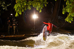 Wet job (apfelmark) Tags: camera light red film sports water lamp night canon river munich mnchen photography photo jump shoot surfer air wave surfing spot crew flip isar tao filming garten englischer eisbach schirrmacher