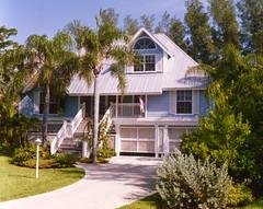 Spyglass Hill Home Plan by The Sater Design Collection (Sater Design Collection) Tags: tinroof dormer frontelevation islandbasement
