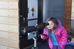 Jovie looking through a scope (Aggiewelshes) Tags: travel winter snow april wyoming olsen jacksonhole visitorcenter jovie grandtetonnationalpark 2016 gtnp