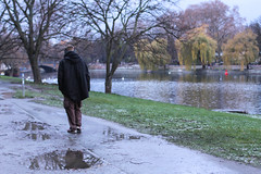 Nostalgic Walker (mariacamussi) Tags: park street travel autumn winter people urban berlin water rain river germany deutschland cool europe mood moody riverside candid young streetphotography nostalgic serene wisdom spree nostalgy protagonist
