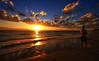 a thousand times over (Bec .) Tags: ocean sea sun man reflection beach water beautiful sunshine clouds canon waves footprints running shore adelaide bec southaustralia 1022mm henleybeach 10mm 450d athousandtimesover