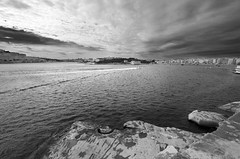 Clouds and Water (albireo 2006) Tags: sea blackandwhite bw coast blackwhite malta pb nb bn coastline seashore blackandwhitephotos marsamxett blackwhitephotos marsamxettharbour