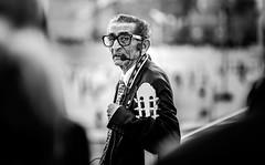 ... The Singer ... ( ... of La Barceloneta ... ) (Fede Falces ( ...♥... )) Tags: barcelona portrait blackandwhite musician man blur contrast eyecontact bokeh guitar candid streetphotography blues oldman singer f28 flamenco patanegra bernardocortés olympusem1 olympusm40150mmf28 bluslerías
