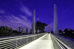 Pedestrian Bridge At Houston Police Officer's Memorial - Blue Hour I (Mabry Campbell) Tags: bridge blue usa clouds photography photo twilight texas photographer image fav50 cloudy dusk unitedstatesofamerica may houston fav20 photograph 100 bluehour fav30 f11 fineartphotography pedestrianbridge walkingbridge bikebridge architecturalphotography 2015 17mm commercialphotography fav10 buffalobayou eleanortinsleypark harriscounty fav40 fav60 architecturephotography 50sec houstonpoliceofficersmemorial fineartphotographer tse17mmf4l runningbridge bikingbridge hariscounty mabrycampbell buffalobayouhikeandbiketrail may232015 houstonstock 20150523h6a6305