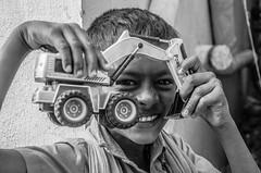 Playtime (saravanakumarg) Tags: street blackandwhite bw happy nikon play indian south lifestyle streetlife joyful madurai tamil tamilnadu happyness streetphotographer lifestory saravanan indianstreetphotography kulamangalam nikond7000 saravananoliyovium tamilclick