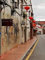 a street decorated (SM Tham) Tags: road street old windows streetart car buildings outdoors person town pavement chinesenewyear unescoworldheritagesite roofs cables malaysia signage lanterns walls melaka doorways malacca airconditioningunits