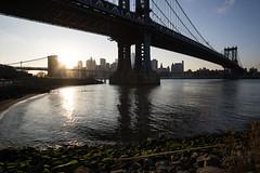 DUMBO Sunset 2 (Daniel Portalatin Photography) Tags: park nyc sunset urban newyork water architecture landscape pier dock rocks cityscape fineart dumbo brooklynbridge manhattanbridge brooklynbridgepark rokinon12mm sonya6000