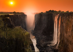 Thundering Smoke (www.fourcorners.photography) Tags: africa landscape sunset victoriafalls zambia mostoatunyanationalpark livingstone waterfalls water peterboehringerphotography orange yellow fourcornersphotography