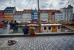 Harbor View in Copenhagen, Denmark (` Toshio ') Tags: copenhagen denmark nyhavn harbor couple europe european ship restaurants danish boardwalk tallship europeanunion toshio xe2 fujixe2