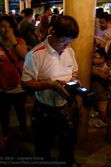Mr Yong checking his gear (Stinkee Beek) Tags: nightsafari