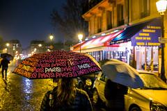 (spatialrhetorics) Tags: street nightphotography france rain night umbrella catchycolors fuji candid streetphotography rainy fujifilm streetphoto parisfrance ilesaintlouis colorstreetphotography colourstreetphotography everydaydetails x100t fujifilmx100t