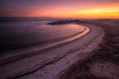 A gently curving beach and a pile of boulders. (MichaelSOwens) Tags: morning beach sunrise rocks waves florida erosion boulders curve prevention hdr fernandinabeach ameliaisland stmarysriver cumberlandsound fortclinchstatepark