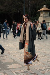 Tokyo... (blondinrikard) Tags: travel boy people look fashion japan tokyo shoes eyecontact dress streetphotography style dressedup streetphoto performer stilts woodenshoes stiltshoes
