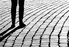 Where are they leading me? (Nils van Rooijen) Tags: street shadow bw white abstract black lines contrast nijmegen legs pavement ground tiles silhouet lent spiegelwaal