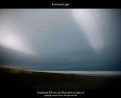 Kariotahi Light (yavorin78) Tags: shadow lighthouse beach night stars kariotahi