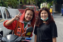 lady motorcycle taxi driver and friend (the foreign photographer - ) Tags: ladies two sign portraits thailand nikon peace bangkok taxi young motorcycle driver khlong bangkhen thanon d3200 jan92016nikon