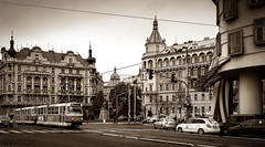 Prague Tram (William MacGregor) Tags: road city blackandwhite building monochrome electric skyline architecture digital canon europe czech prague image outdoor ngc transport tram 5d dslr czechoslovakia damncool 50d photoborder yourbestoftoday peopleinphoto macgregorwilliam