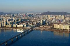 Icy Seoul, Korea (gregmartinn) Tags: city travel bridge winter mountain ice architecture river landscape frozen cityscape traffic korea seoul metropolis