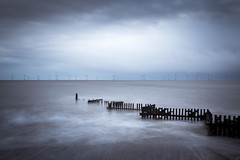 British Sea Power (Draws_With_Light) Tags: camera longexposure winter sea storm beach glass clouds sunrise canon season landscape eos is long exposure wind mark iii norfolk hard structures places scene 09 lee nd pro 5d coastline usm filters grad f4 turbine windturbine stormclouds groynes caister caisteronsea ef1635mm 09nd canoneos5dmarkiii lee09ndhardgrad leeproglass09nd ef1635mmf4isusm