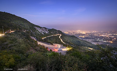 Panoramic view of Islamabad, Pakistan. (Shahid A Khan) Tags: road city travel pakistan light sky panorama mountain nature beautiful landscape photography nikon asia view outdoor background horizon country picture places panoramic hills photograph valley d750 destination winding nightscene islamabad margalla traillights descriptivewords shahidakhan sakhanphotography wwwgalleryskcom