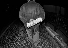 Into the darkness for newspapers!! (Baz 120) Tags: life street city portrait people urban blackandwhite bw italy rome roma monochrome mono europe italia faces candid strangers streetphotography streetportrait olympus monotone manual unposed streetfaces omd decisivemoment candidportrait candidphotography m43 streetcandid mft streetphotograph primelens em5 romestreets romepeople candidstreet zonefocusing candidface flashstreetphotography 75mmfisheye romecandid grittystreetphotography