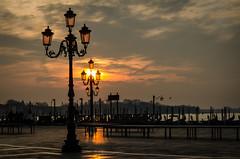 Venice at sunrise (hjuengst) Tags: italien venice light italy orange clouds sunrise reflections italia dusk urlaub wolken venezia sonnenaufgang venedig piazzasanmarco wolkig markusplatz morgendämmerung diamondclassphotographer flickrdiamond nikond7000 tagesjahreszeiten pwpartlycloudy