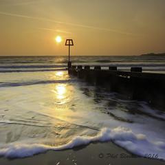Sunrise on Swanage Beach (Phil Bloxham) Tags: longexposure sea sunlight seascape canon landscape coast slow dorset serene groyne purbeck leefilters