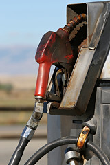gas pump (Chu Vit c) Tags: old red urban industry station vertical rising energy industrial decay grunge cost rusty dirty gas used pump transportation messy oil oily costs petrol gasoline grime economic expensive economy luxury fuel greasy nozzle petroleum