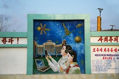 Mural in Rajin (Rason) (Frhtau) Tags: world life street autumn people colour building art history del asian design town photo construction mural asia do leute view outdoor centre traditional main country kultur north central picture culture style scene korea du daily line east korean era architektur leader mode dach farbe gebude nord norte rebuilt rajin core corea dprk coria coreia nordkorea   rason  gebudekomplex