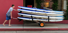 Surfboards Go Home (Russ Allison Loar) Tags: ocean summer vacation beach sport sand surfer surfing newportbeach pacificocean surfboards watersports southerncalifornia youngman summerjob balboaisland minimumwage beachcity californialifestyle paddleboards teenemployment