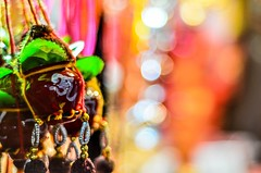 trinkets   (s) Tags: india colors 50mm lights dof nightshot bokeh depthoffield kolkata bengal trinkets calcuta kalighat  kalitemple nikond7000 pavementshop