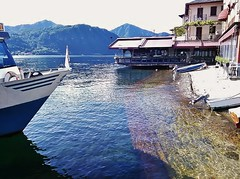 Where water meets land (SM Tham) Tags: italy lake mountains water ferry buildings boat town waterfront lakeorta italianlakes ortasangiulio
