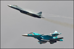 Sukhoi Su-34 + T-50 (Pavel Vanka) Tags: plane airplane fly flying fighter russia moscow jet spot formation airshow planes stealth missile spotting weapons platypus fifth armed maks sukhoi fullback lii fighterbomber t50 5thgeneration su34 formationflight ramenskoe zhukovskiy russianairforce sukhoit50