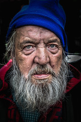 Man with a disc ear ring (eyecandyclick) Tags: old portrait face look hat mouth beard nose grey eyes earring lips eccentric wrinkles