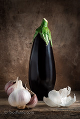 Aubergine with garlic on wood (foodfulife) Tags: stilllife food art kitchen beautiful vegetables vertical fruit composition dark print photography warm colours eggplant fineart creative fresh aubergine organic foodphotography garlicskin garliccloves onwood woodenbackground foodportraits