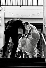 adjustments (Dean Forbes) Tags: seattle bw groom bride candid pikeplacemarket weddingshoot