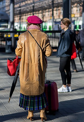 Miss Marple solves difficult crimes because of her shrewd intelligence (Poupetta) Tags: woman umbrella finland bag helsinki candid voyager beret suitcase railwaysstation