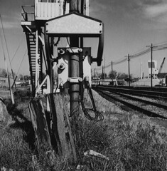 GATE BALANCE(Q) (A) YASHICA MAT, KODAK FILM, 1960'S (grogerclements) Tags: railroad yard crossing tracks weatherd