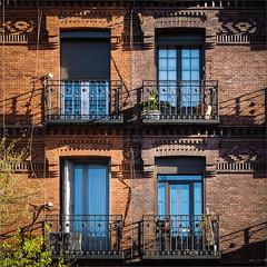 Cuatro (real ramona) Tags: madrid blue windows light four spain shadows bricks sunny foliage shutters balconies quattro quatre