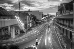 The Biker. - Penang. (Tony Kioh JunHui) Tags: street longexposure travel light sunset summer sky bw motion love monochrome architecture clouds digital wow landscape photography asia cityscape cloudy outdoor dusk sony trails symmetry georgetown explore malaysia nightlife bluehour penang truly hdr cloudscape urbanscape blending komtar travelphotography pulaupinang a37 travelscape rocolax
