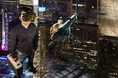 Man standing in virtual reality scene (mezzotint_de) Tags: city fiction usa newyork building metal skyline architecture night america skyscraper buildings lights glasses high technology unitedstates display manhattan aircraft platform business helicopter entertainment fantasy virtual transportation reality recreation concept suitcase goggle aluminium holodeck