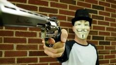 Dodge This... (disgruntledbaker1) Tags: cinema movie nikon gun mask wideangle brickwall trinity 1855mm thematrix 18mm d90 annonymous dodgethis disgruntledbaker