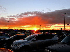 Sunset Over a Sea of Cars (Chuck Wilkins) Tags: sunset sky cars clouds autos flickrstars