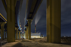 Under the High Rise (CJ Schmit) Tags: longexposure nightphotography bridge winter urban snow wisconsin canon lowlight downtown industrial shadows smoke overpass smokestack freeway milwaukee interstate powerplant i94 mke shutterdrag marquetteinterchange starlights canonef1740mmf40lusm weenergies menomoneerivervalley canon5dmarkiii cjschmit 5dmarkiii wwwcjschmitcom cjschmitphotography