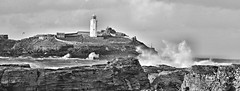 DSC_1685 GREY DAY AT GODREVY (mike193823319483) Tags: ocean sea england lighthouse rocks cornwall december united kingdom windy spray niko f8 greyday northatlantic 2015 d600 iso1000