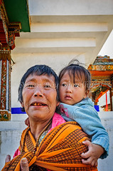 Old Lady, gendmother carrying baby in a sack on her back (Shutter Shooter) Tags: old travel woman baby tourism public senior girl smiling happy back toddler tour child bhutan grandmother buddha buddhist buddhism granddaughter mature local thimpu sack devotee wrinkle grandparent bhutanese carrying traveler thimphu mongoloid 2013 adlt